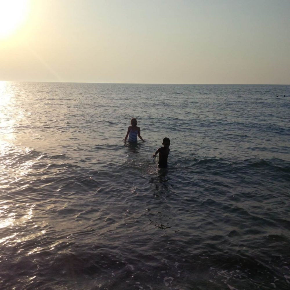 Things to do in Paphos- Sunset swimming at Argaka Beach