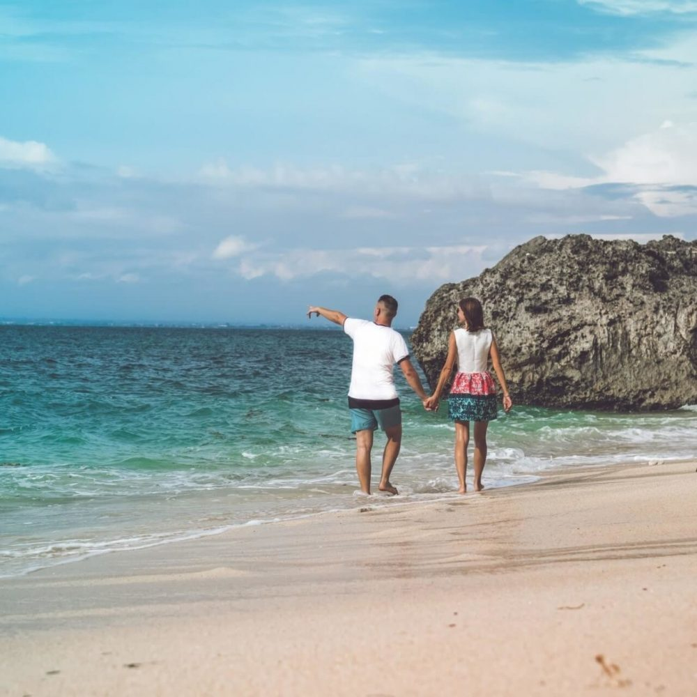 Things to do in Paphos - Happy couple stroll on the beach